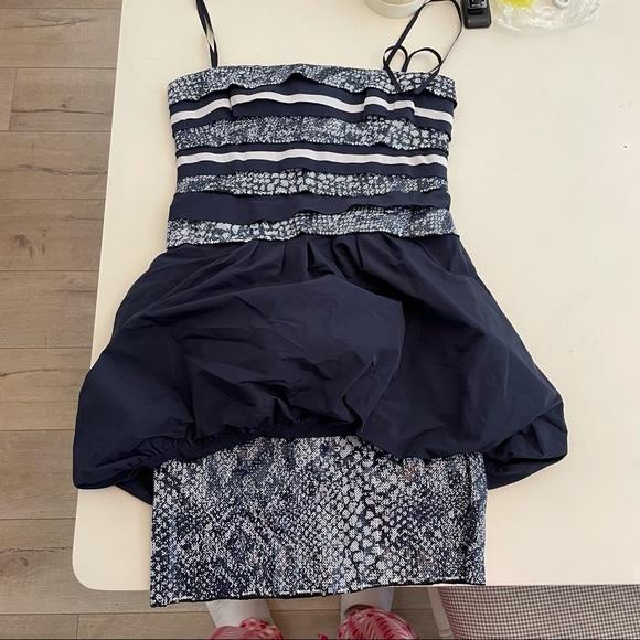 NEED GONE BCBG sequin peplum snakeskin print dress